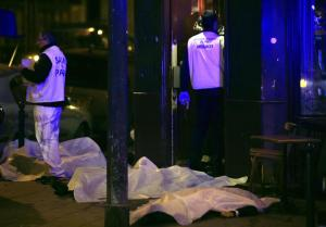 Victims lay on the pavement in a Paris restaurant, Friday, Nov. 13, 2015. Two police officials say at least 11 people have been killed in shootouts and other violence around Paris. Police have reported shootouts in at least two restaurants in Paris. At least two explosions have been heard near the Stade de France stadium, and French media is reporting of a hostage-taking in the capital. (ANSA/AP Photo/Thibault Camus)